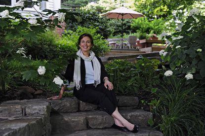 Carol Macht, FASLA, is pictured at her home garden in Towson.