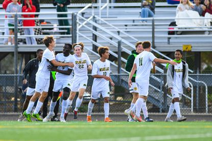 Wilde Lake celebrates goal scored by Ousman Touray against River Hill during the second half at River Hill High School on Saturday, Oct. 5, 2019.