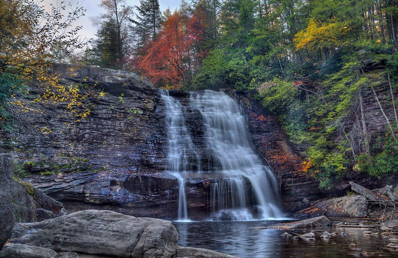 The highest free-falling waterfall in Maryland, Muddy Creek Falls is located in Swallow Falls State Park. Standing at about 60 feet, the falls are part of the Pottsville Formation, which is made up of eroded siltstones and shales, as well as cross-bedded sandstones that date back about 300 million years. (KhanlM/Shutterstock).