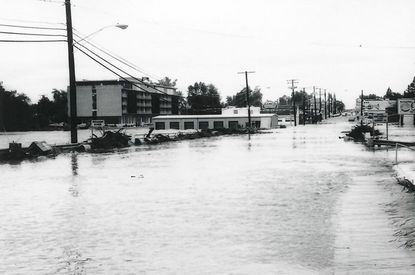 Southbound Route 1 was divided by flood water in this 1972 photo that shows the former Howard Johnson Motor Lodge and the AAMCO building on the left.