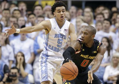 North Carolina's Marcus Paige (5) guards Maryland's Rasheed Sulaimon (0) during the first half in Chapel Hill, N.C., Tuesday, Dec. 1, 2015.