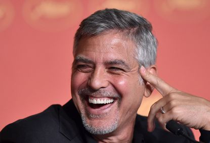 "George Clooney laughs on May 12, 2016 during a press conference for the film ""Money Monster"" at the 69th Cannes Film Festival in Cannes, southern France."