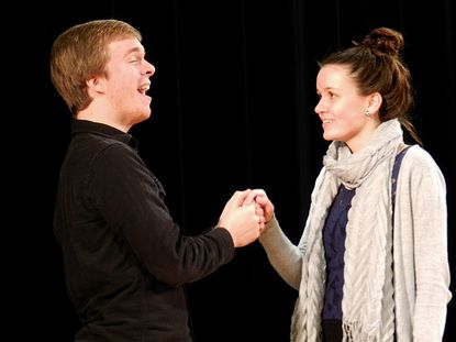 """Junior Julian Schoming and senior Emma Shipley sing together during a rehearsal of Manchester Valley High School's production of """"How to Succeed in Business Without Really Trying"""" on Nov. 5."""