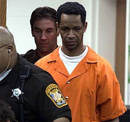 Sniper suspect John Allen Muhammad is escorted into Prince William County Circuit Court in Virginia yesterday for a pretrial hearing.