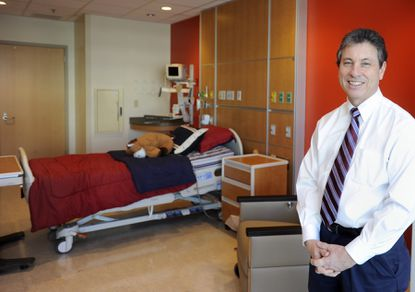 Dr. Joseph Wiley, chairman of the Department of Pediatrics at Sinai, stands in one of the new patient rooms at the new Herman and Walter Samuelson Children's Hospital at Sinai.