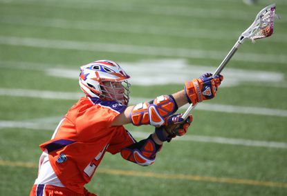 Kevin Crowley of the Hamilton Nationals catches a pass during a Major League Lacrosse game against the Denver Outlaws. Crowley's career-best season led the Nats to the best regular-season record (9-5) in franchise history.