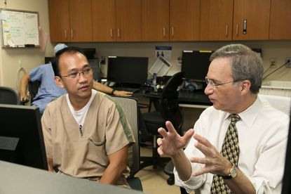 Dr. Hal Tucker (right) discusses his vision for the future of GBMC's employed physician group with a staff member. This paid post is produced by Motiv8 Agency on behalf of Greater Baltimore Medical Center. The newsroom or editorial department of Tribune Publishing was not involved in its production.