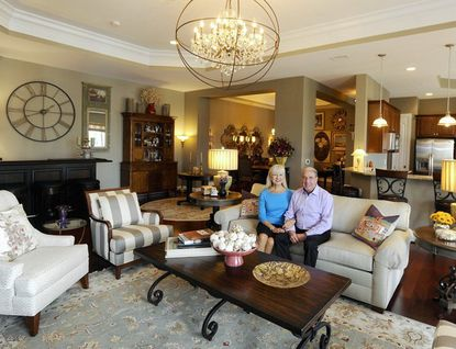 Barry and Olga Scher sit in the living room of their dream home in the Grand View condominiums in Annapolis Towne Centre at Parole.