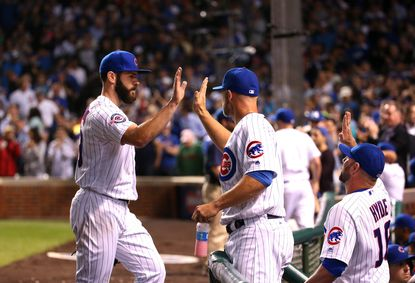 Jake Arrieta is congratulated after getting out of a jam to finish off the Dodgers in the 7th inning at Wrigley Field on May 31, 2016.