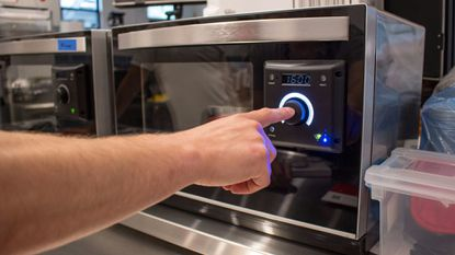 Tovala Chief Culinary Officer Alexander Plotkin demonstrates how to use the startup's smart oven in July 2017.