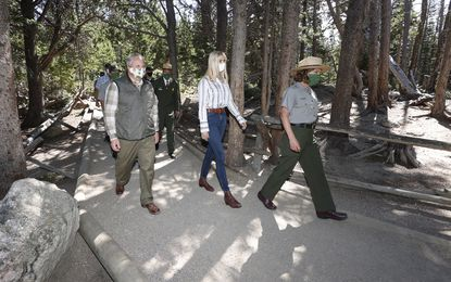 Presidential advisor Ivanka Trump, center, and U.S. Interior Secretary David Bernhardt, left, walk around Bear Lake after speaking at a news conference to highlight the Great American Outdoors Act Thursday, July 23, at Rocky Mountain National Park.