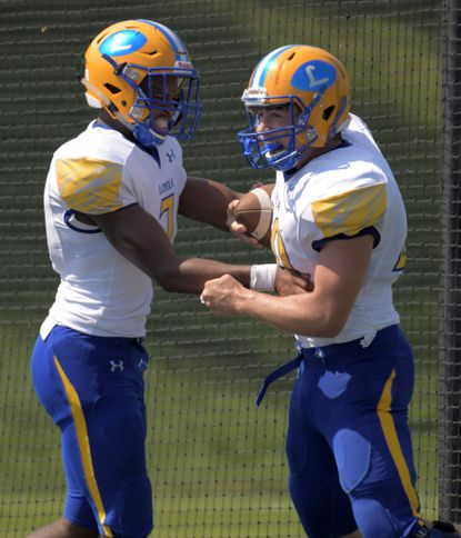 Loyola Blakefield Dons defensive end Joshua Buck (left) and linebacker Kyle Powell celebrate their block of a Gilman Greyhounds punt at Alexander Sotir Stadium Sat., Aug. 31, 2019. Powell recovered the fumble to score a touchdown.