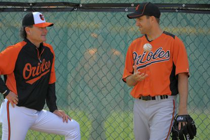 Rick Peterson, left, stands with Orioles pitcher Brad Bergesen during spring training in February.