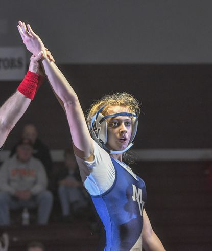 In what's claimed to be the first girls varsity wrestling bout in Carroll County, Manchester Valley's Summer Shackleford emerges victorious after she defeats Winters Mills' Alivia Esworthy Tuesday night in Westminster.