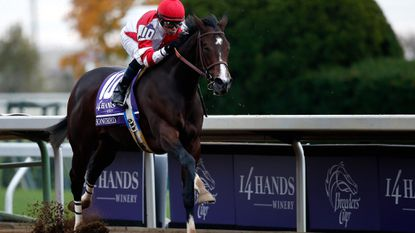 Jockey Mike Smith rides Songbird to the win in the Breeders' Cup Juvenile Fillies at Keeneland Racecourse on Saturday.