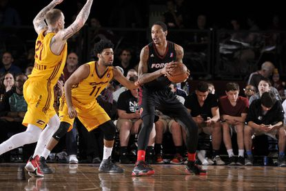 Greg Whittington, center, of the Sioux Falls Skyforce controls the ball against Quinn Cook of the Canton Charge during a game on April 12.