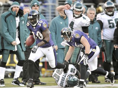 Ed Reed (left) returns an interception 108 yards for a touchdown in the fourth quarter. Reed, who broke his own NFL record on the play, picked off another pass in the second quarter.