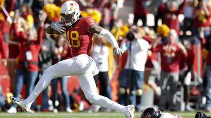 Iowa State wide receiver Hakeem Butler runs from Texas Tech defensive back Damarcus Fields during a 48-yard touchdown reception in the second half Saturday, Oct. 27, 2018, in Ames, Iowa.