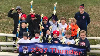 The Freedom Soccer Club boys under-11 youth soccer team won the Fallston Cup tournament in November.