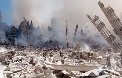 FILE — In this Sept. 12, 2001 file photo, firefighters work in the rubble of the World Trade Center towers in New York. (AP Photo/Virgil Case, File)