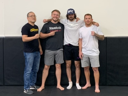 From left, Julius Park, Sebastian Ramirez, Matthew Semelsberger and Jon Delbrugge pose for a photo. Semelsberger realized a childhood dream when he signed a multi-fight contract with the Ultimate Fighting Championship Friday at his training facility, Crazy 88 Mixed Martial Arts in Elkridge.