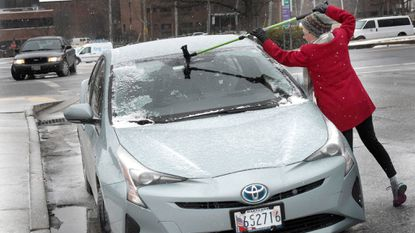 Jan Flora scrapes ice off her windshield along Paide Way in Westminster Monday January 8, 2018.