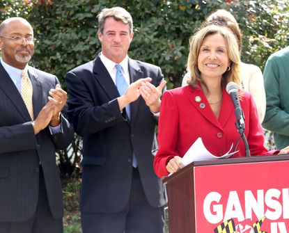 Del. Jolene Ivey speaks to reporters after Attorney General Douglas F. Gansler (right, next to Ivey's husband Glenn Ivey) announces her as his running mate.