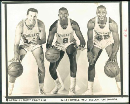 Former Baltimore Bullets center Walt Bellamy, center, died Saturday at the age of 74.