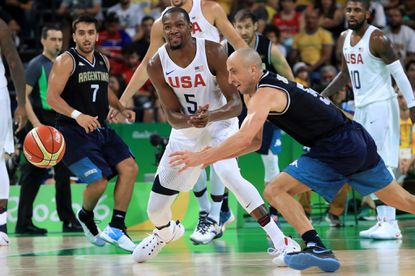 Kevin Durant of the United States and Manu Ginobili of Argentina go after the ball during the Men's Quarterfinal match on Day 12 of the Rio 2016 Olympic Games at Carioca Arena 1 on August 17, 2016 in Rio de Janeiro, Brazil.