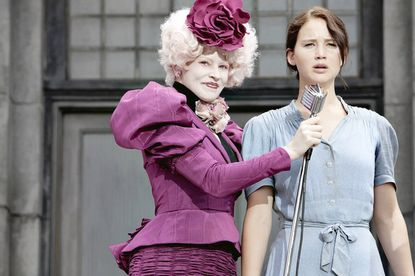 "Elizabeth Banks (left) and Jennifer Lawrence star in ""The Hunger Games."" The movie -- based on a series of best-selling novels -- opens in theaters this weekend, but many Baltimore-area shows are already sold out."