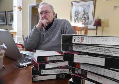 Don Soeken, former whistleblower in the federal government, started the nonprofit Whistleblower Support Fund in 1989 before leaving his government job in the early 1990s. The Ellicott City resident is pictured among video tapes of whistleblower testimonies and TV interviews he has collected over the years.
