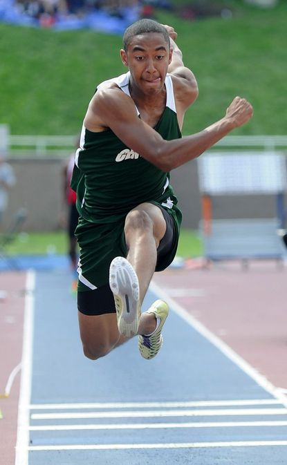 Century's Julian Woods competes in the triple jump during the Class 2A state track and field meet in Baltimore May 26.