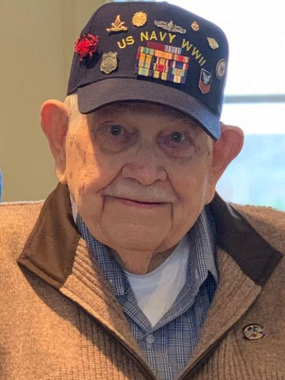 Edward R. Daughaday, a Navy veteran from World War II, made museum-quality wooden models of Chesapeake Bay ships and boats. (Courtesy photo)