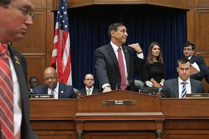 House Oversight and Government Reform Committee Chairman Darrell Issa (R-CA) (C) orders ranking member U.S.Rep. Elijah Cummings' (D-MD) microphone turned off after adjourning a hearing in the Rayburn House Office Building March 5, 2014 in Washington, DC. Issa adjuourned after the witness, former Internal Revenue Service official Lois Lerner, exercised her Fifth Amendment right not to speak about the IRS targeting scandal during the hearing.