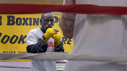 Dorian Bostic trains with sparring partner Dominick Robinson at Umar Boxing for his first professional fight, which he won Saturday night.