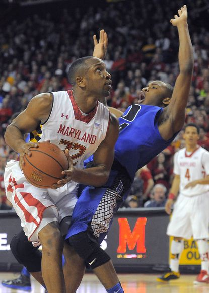 Maryland guard/forward Dez Wells drives to the basket in the first half of a victory against Duke.