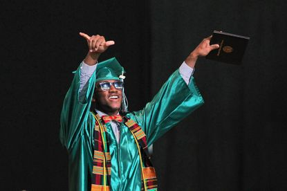Matthew Peart smiles after getting his diploma May 30 during Atholton High School'sClass of 2012 commencement at Merriweather Post Pavilion in Columbia.