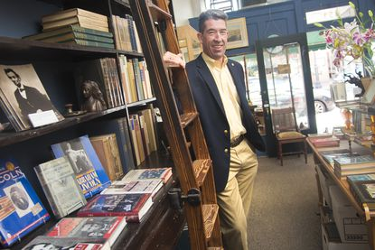 Rock Toews stands inside his business, Back Creek Books in Annapolis. Toews, a Republican who previously ran for the Ward 8 City Council seat in 2009, has filed to run once again.