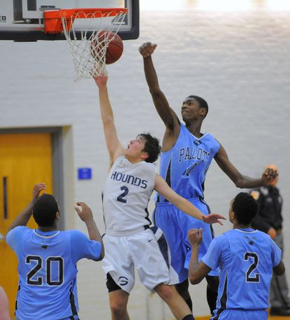 Saint Vincent Pallotti's Tariq Owens, shown blocking the shot of Gilman's Ben Grace in 2012, is currently averaging 8.5 points per game at St. John's University.