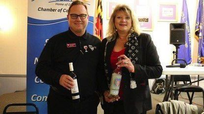 Scott Paul, left, and Diane Moore of Harco Credit Union showcase Spanish wine at the 2018 Aberdeen Chamber of Commerce Taste of Cheer event. This year's event, the eighth annual, will be at Ripken Stadium on April 26.