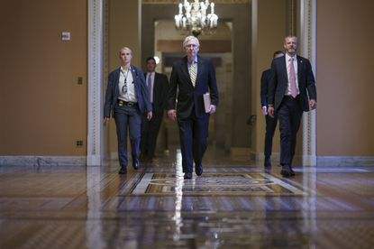 Senate Minority Leader Mitch McConnell, R-Ky., walks to the chamber as Republicans block approval of the For the People Act, a sweeping bill that would overhaul the election system and voting rights, at the Capitol in Washington, Tuesday, June 22, 2021. The bill has been a top priority for Democrats seeking to ensure access to the polls and mail-in ballots. (AP Photo/J. Scott Applewhite)