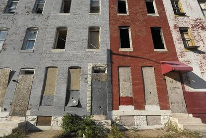 Boarded-up homes on Biddle Street in Baltimore.