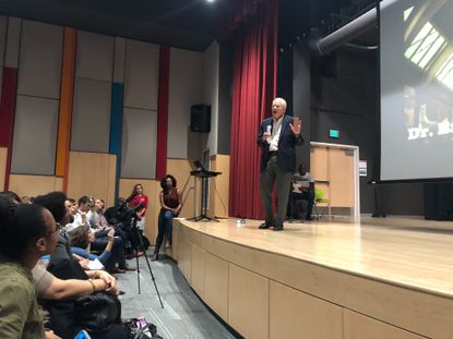 "William E. ""Brit"" Kirwan addresses a standing room-only crowd at Dorothy I. Height Elementary gathered to demand that the necessary amount of money come through for the city's historically underfunded schools."