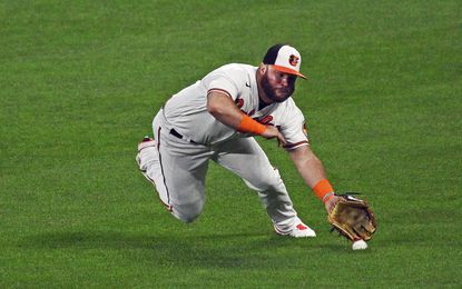 Orioles right-fielder DJ Stewart is not able to catch the fly ball by Astros' Myles Straw which drove in the go-ahead run in the seventh inning.