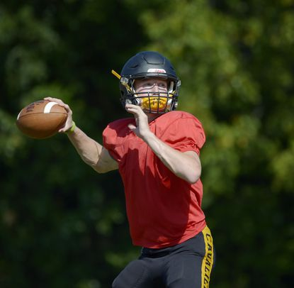South Carroll quarterback Dylan O'Neill throws a pass during a practice in Winfield Tuesday, Sept. 3, 2019.