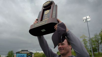 Towson Tigers head coach Shawn Nadelen holds up the trophy during the 2017 CAA Men's Championship Final at Johnny Unitas Stadium.