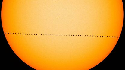A composite photo from NASA showing the most recent transit of Mercury, on May 9, 2016. MUST CREDIT: NASA