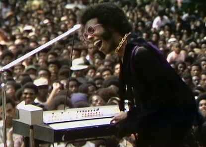 """Sly Stone, of Sly and The Family Stone, shown performing at the 1969 Harlem Cultural Festival. Director Ahmir """"Questlove"""" Thompson's documentary """"Summer of Soul""""dives deep into the festival, which took place the same year as Woodstock and included performances from Nina Simone, Stevie Wonder, Mahalia Jackson, and B.B. King. The music is outstanding, but Thompson also uses the documentary to show how many Black artists responded in their work to the civil rights era. It is now streaming on Hulu. (Concordia Studio)"""