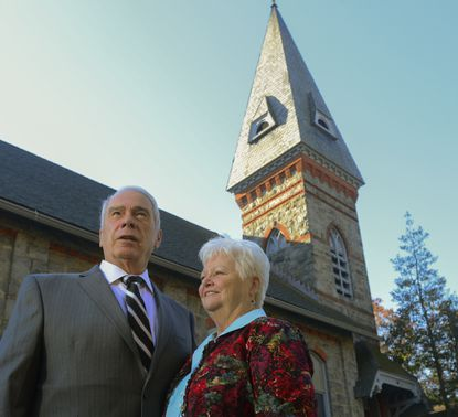 State Sen. James N. Robey and his wife, Janet Robey, both of whom grew up in Daniels, stand outside Gary Memorial United Methodist Church, where they still attend services.