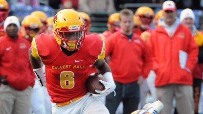 Calvert Hall wide receiver Morgan Scroggins, left, breaks a tackle to score a touchdown asCalvert Hall defeated Loyola 25-22 to win the 95th Turkey Bowl, at M&T Bank Stadium.